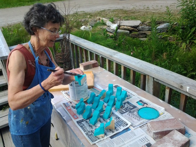 Claire staining blocks on a nice summer day.