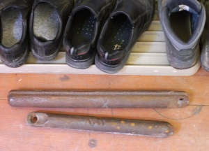 Iron weights, with shoes for scale.