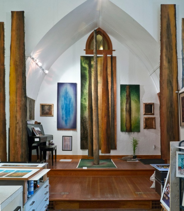 A display of Claire's forest-based work in the altar area.